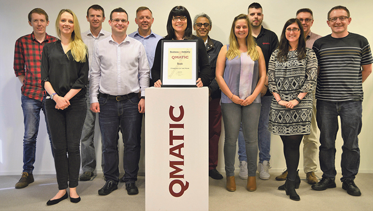 Qmatic team receives the Company of the Year Award from our journalist
